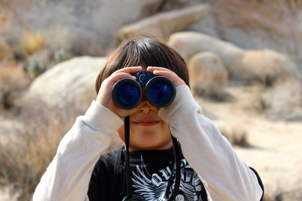looking for things as a boy with binoculars