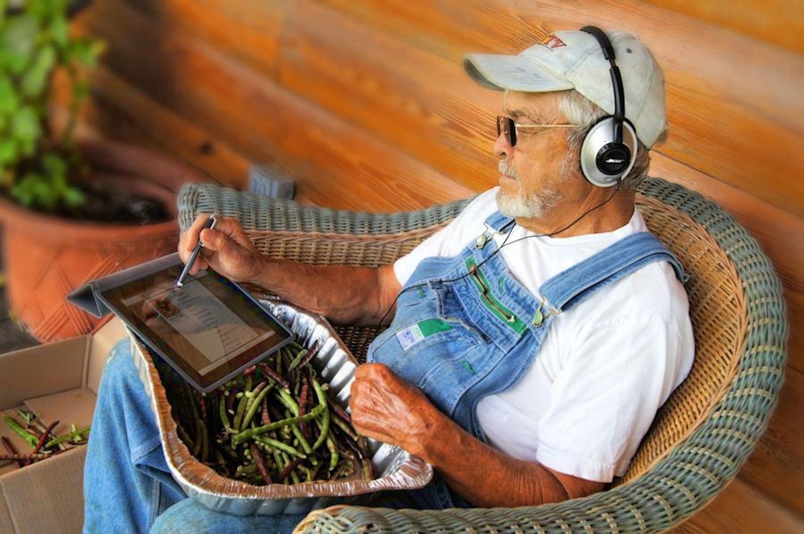farmer using ipad to check results